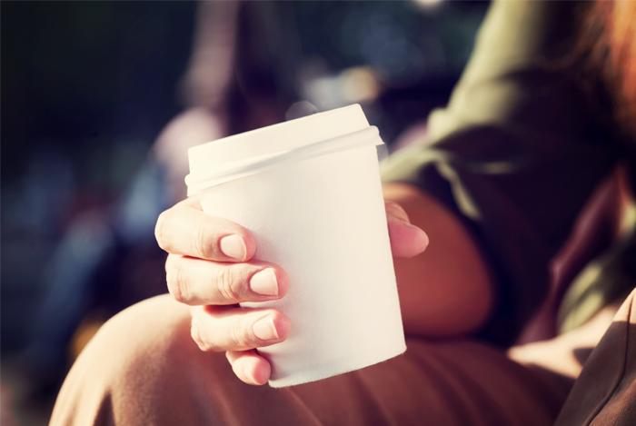 holding coffee take away