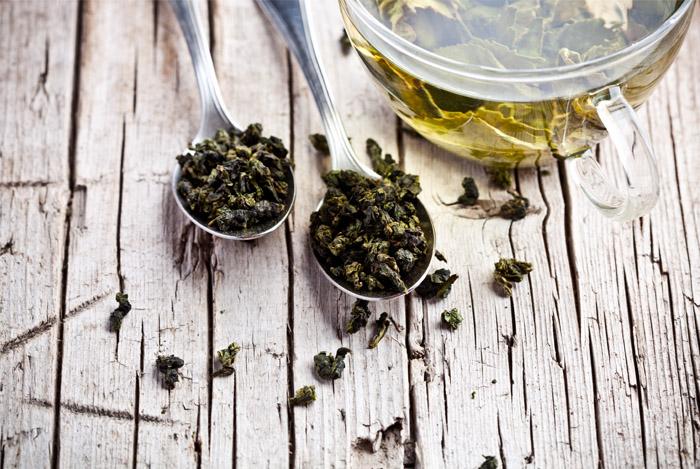 green tea leaves spoon cup