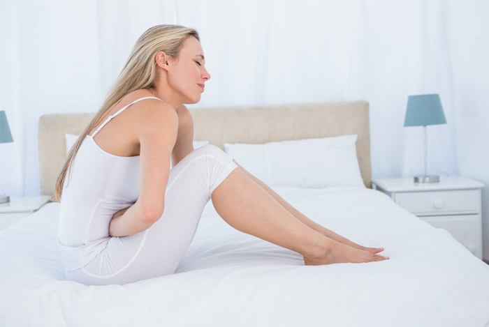 stomach pain woman bed