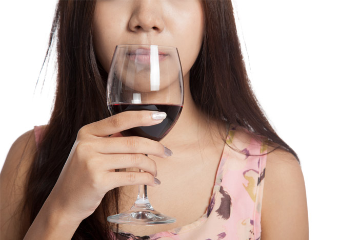 woman drinking red wine glass