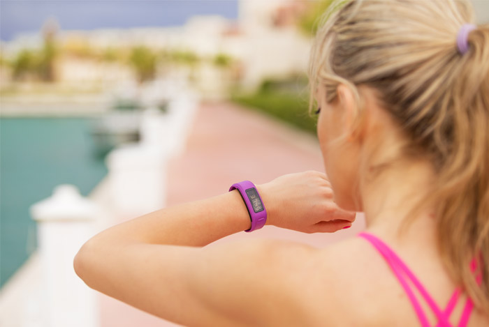 woman looking at sports watch