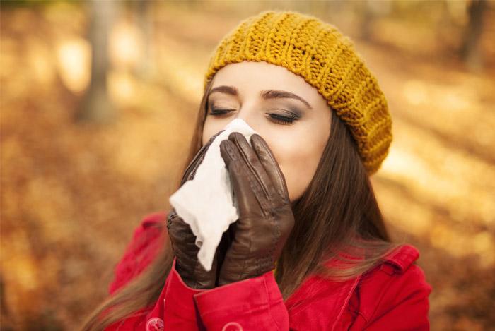 woman sneezing immunity
