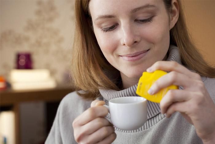woman using aspartame