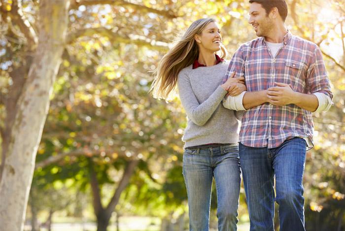 happy healthy couple walking